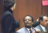 Lead defense attorney Johnnie L. Cochran, Jr., center, gestures towards prosecutor Marcia Clark, left, during the trial of former NFL star running back O.J. Simpson for the murder of his former wife, Nicole Brown Simpson and a friend of hers, restaurant waiter, Ron Goldman in Los Angeles County Superior Court in Los Angeles, California on July 13, 1995.  Defense attorney Robert Shapiro is at right.<br /> Credit: Steve Grayson / Pool via CNP