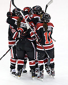 Katie MacSorley (Northeastern - 3), Colleen Murphy (Northeastern - 10), Maggie DiMasi (Northeastern - 4), Lucie Povova (Northeastern - 92) and Rachel Llanes (Northeastern - 11) celebrate DiMasi's goal. - The Boston University Terriers defeated the visiting Northeastern University Huskies 3-2 on Saturday, January 28, 2012, at Agganis Arena in Boston, Massachusetts.