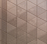 Abstract texture of metal architectural element with triangular pattern