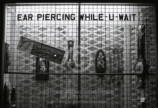 Ear Piercing While You Wait, London, 1973-6.<br />