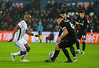 2nd January 2020; Liberty Stadium, Swansea, Glamorgan, Wales; English Football League Championship, Swansea City versus Charlton Athletic; Andrew Ayew of Swansea City looks to go past Jason Pearce of Charlton Athleic - Strictly Editorial Use Only. No use with unauthorized audio, video, data, fixture lists, club/league logos or 'live' services. Online in-match use limited to 120 images, no video emulation. No use in betting, games or single club/league/player publications