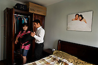 Liu Yi (leoh E) +86 138 1001 5583 liuyi@zhanzuo.net.at her home with her husband and her parents. Husband is Ryan and his mobile is +86 139 1016 6633. She is assistant to Jack, the CEO and recently married. She used her marriage as an excuse to get out of a boring insurance company.  But she was out of work for 6 months.  She says this place has changed her life... but basically she just likes a more vibrant workplace.  She makes about USD 500 a month..www.eyou.com offices.  They have a climbing wall... the CEO's computer used to found the company is embedded in one of the walls... equations are worked out on the glass walls of the managers offices. The guy on the climbing wall is Ruan Guowei, nuangw@eyou.net  +86 135 0117 6129.Contacts for the company are: CEO Jack Zhou+86 139 1066 6168  and PR manager Luo Peng +86 139 1041 1230 luopeng@zhanzuo.net.Contact is Evelyn +86 137 1896 4824