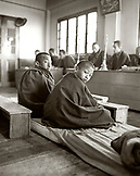 INDIA, West Bengal, monks and students at monastery, Samten Choling Monastery, Ghoom (B&W)