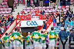 A defeated Kerry team look on as Cork receive the silver ware last Wednesday night in Pairc Ui Chaoimh, Cork in the Munster GAA Junior Football Championship.