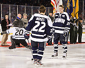 Stevie Moses (UNH - 22), Nick Sorkin (UNH - 21) - The University of Maine Black Bears defeated the University of New Hampshire Wildcats 5-4 in overtime on Saturday, January 7, 2012, at Fenway Park in Boston, Massachusetts.