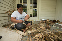 NWA Democrat-Gazette/BEN GOFF @NWABENGOFF Wilpina Batlok helps slices leaves into strips that will be woven into the sail for the KorKor Tuesday, May 8, 2018, at the Shiloh Museum of Ozark History in Springdale. Master canoe builder Liton Beasa and his family, in partnership with the Shiloh Museum of Ozark History, began building the two-man Marshallese canoe called a KorKor April 14 and plan to display the finished canoe at the Little Craft Show Saturday in downtown Springdale.