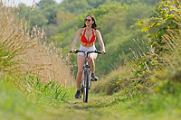 WEATHER PICTURE WALES<br /> Pictured: Natasha Jenkins enjoys the hot weather on her bicycle by Tennant Canal near Neath, Wales, UK. Thursday 23 April 2020
