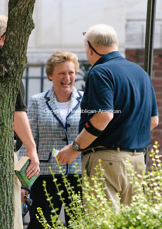 WATERBURY, CT - 15 August 2012-081512EC05--   Maria Moulthrop laughs with relatives and her attorney outside of court along Grand Street in Waterbury Wednesday morning.  The former elementary school principal was arrested in June for allegedly taking ten thousand dollars from a student fund.  Erin Covey Republican American.