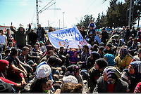 Pictured: Migrants sit on the railway track Thursday 03 March 2016<br /> Re: Migrants have closed off the railway track at the Greek Fyro Macedonian border in Idomeni, Greece,