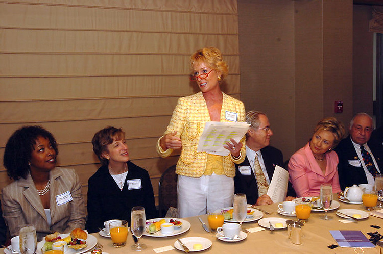 Kathy Kemper (center) is flanked by (from left) Gina Adams, Ann Friedman, George Vradenburg, Sen. Hillary Rodham Clinton and Carter Pate at a recent INFO breakfast, which for years has served as a bipartisan way to network in D.C.
