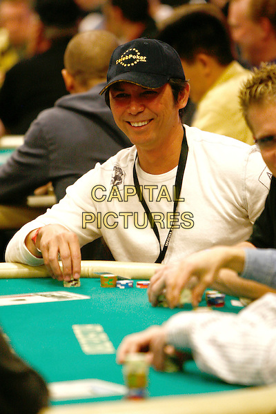 LOU DIAMOND PHILLIPS.World Poker Tour Invitational, Commerce, California, USA..February 22nd, 2006.Photo: Byron Purvis/AdMedia/Capital Pictures.Ref: BP/ADM.half length baseball cap hat chips.www.capitalpictures.com.sales@capitalpictures.com.© Capital Pictures.