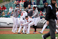 Rochester Red Wings Luis Arraez (9) celebrates a walk off single with Tomas Telis, Brent Rooker (19), Jake Reed, and Jordany Valdespin during an International League game against the Charlotte Knights on June 16, 2019 at Frontier Field in Rochester, New York.  Rochester defeated Charlotte 3-2 in the second game of a doubleheader.  (Mike Janes/Four Seam Images)