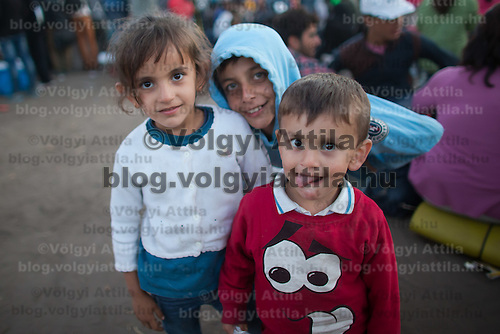 Illegal migrant children pose for a photo at a refugee camp near Roszke (about 174 km South of capital city Budapest), Hungary on September 07, 2015. ATTILA VOLGYI