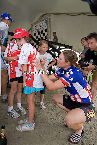 Mary Mcconneloug 37 of Chilmark MA signs a fan's shirt after winning the 2008 Pro womens cross country mountian bike event during the USA cycling mountian bike championships at Mount Snow in Dover Vermont.