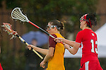 Los Angeles, CA 02/28/14 - Amanda Johansen (USC #7) and Jamie Romano (Marist #13) in action during the Marist Red Foxes vs University of Southern California Trojans NCAA Women's lacrosse game at Loker Track Stadium on the USC Campus.  Marist defeated USC 12-10.