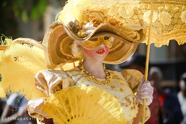 Trinidad carnival, traditional mas, girl playing a Dame Lorraine in yellow