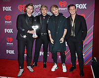 LOS ANGELES, CA. March 14, 2019: 5 Seconds of Summer, Luke Hemmings, Calum Hood, Michael Clifford &amp; Ashton Irwin at the 2019 iHeartRadio Music Awards at the Microsoft Theatre.<br /> Picture: Paul Smith/Featureflash