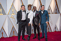 (Left to Right) Jason Clarke, Oscar&reg; nominee Dee Rees, Rob Morgan, and Garrett Hedlund arrive on the red carpet of The 90th Oscars&reg; at the Dolby&reg; Theatre in Hollywood, CA on Sunday, March 4, 2018.<br /> *Editorial Use Only*<br /> CAP/PLF/AMPAS<br /> Supplied by Capital Pictures