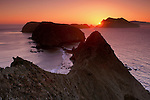 Sunset light over Pacific Ocean and steep coastal cliffs of Anacapa Island, Inspiration Point, Channel Islands National Park, California