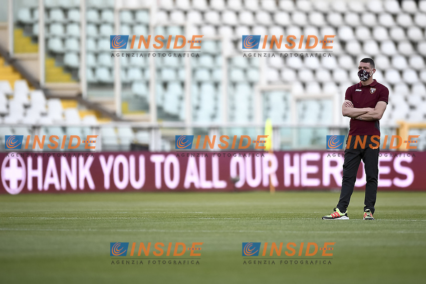 Andrea Belotti of Torino FC stands, wearing a mask, in front of the leds readings Thank you to all our Heroes dedicated to healthcare personnel prior to the Serie A football match between Torino FC and Udinese at Olimpico stadium in Torino ( Italy ), June 23th, 2020. Play resumes behind closed doors following the outbreak of the coronavirus disease. <br /> Photo Image Sport / Insidefoto