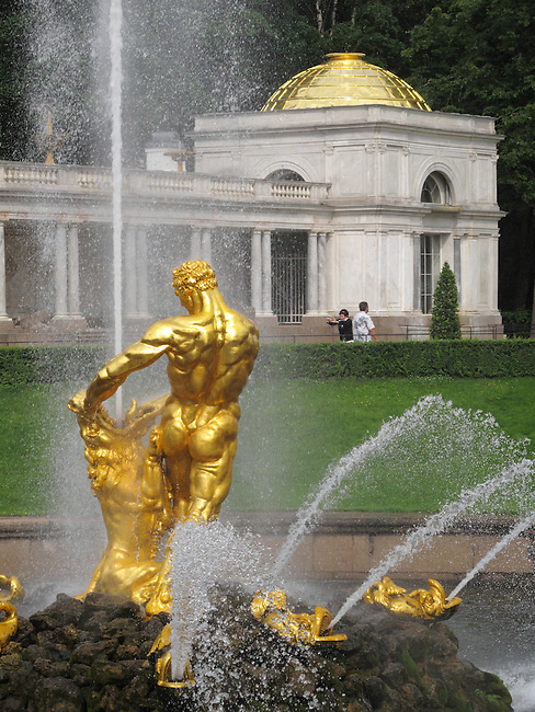 Gilded statue of Samson Rending Open the Jaws of the Lion, and fountains at Peterhof Palace. Near St. Petersburg, Russia.