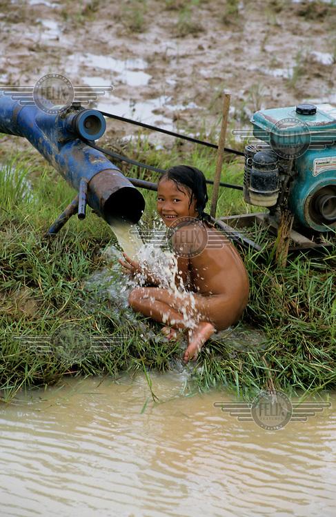 A young girl washing.