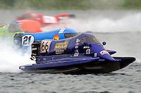 Dana Tomes (#66), Jose Mendana, Jr. (#21), Carlos Mendana (#27) and Jeff Shepherd, (#38)     (Formula 1/F1/Champ class)