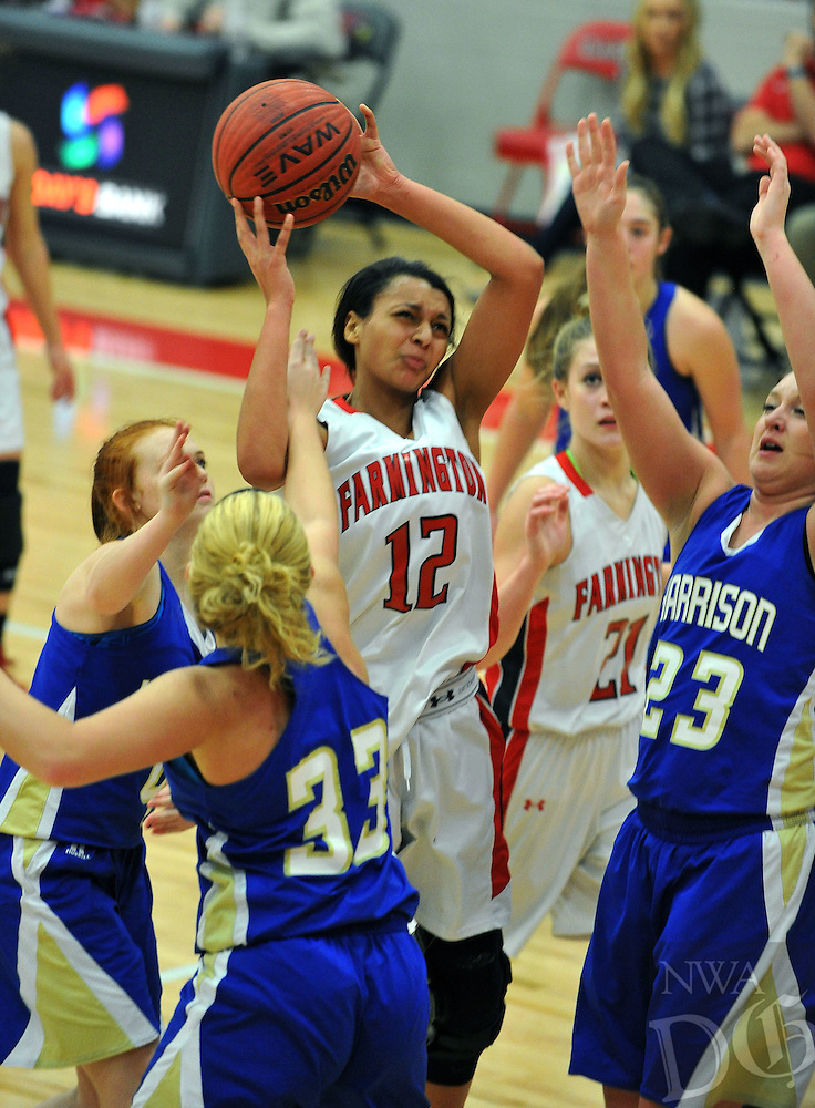 NWA Democrat-Gazette/MICHAEL WOODS • @NWAMICHAELW<br /> Kayla Brown (12) Farmington forward, is fouled as she tries to drive to the hoop past Harrison defenders Briley Due (33) and Emily Harp (23) Tuesday January 12, 2016 during their game at Cardinal Arena in Farmington.