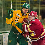 19 February 2016: University of Vermont Catamount Defenseman Mitch Ferguson, a Sophomore from Calgary, Alberta, his checked by Boston College Eagle Teddy Doherty, a Senior from Hopkinton, MA, in the first period at Gutterson Fieldhouse in Burlington, Vermont. The Eagles defeated the Catamounts 3-1 in the first game of their weekend series. Mandatory Credit: Ed Wolfstein Photo *** RAW (NEF) Image File Available ***