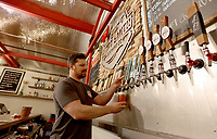 NWA Democrat-Gazette/DAVID GOTTSCHALK Quentin Willard, one of the owners of the Fort Smith Brewing Company pours a draft beer Thursday, November 21, 2019, inside the tasting room at the brewery located at 7500 Fort Chaffee Boulevard in Fort Smith.