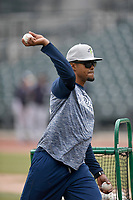 Coach Gilbert Gomez (10) of the Columbia Fireflies pitches batting practice before a game against the Charleston RiverDogs on Friday, April 5, 2019, at Segra Park in Columbia, South Carolina. Charleston won, 6-1. (Tom Priddy/Four Seam Images)