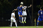 19 September 2014: Duke's Nick Palodichuk (11) and North Carolina's C.J. Odenigwe (22) challenge for a header. The Duke University Blue Devils hosted the University of North Carolina Tar Heels at Koskinen Stadium in Durham, North Carolina in a 2014 NCAA Division I Men's Soccer match. Duke won the game 2-1.