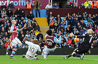 Andre Ayew of Swansea City has his shot saved by Goalkeeper Brad Guzan of Aston Villa during the Barclays Premier League match between Aston Villa v Swansea City played at the Villa Park Stadium, Birmingham on October 24th 2015