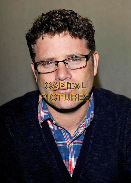 Sean Astin.Collectormania 18 at Stadium: MK, Milton Keynes, Buck, England..3rd June 2012.headshot portrait black blue pink check shirt glasses .CAP/JIL.©Jill Mayhew/Capital Pictures..
