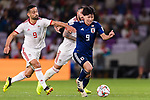 Minamino Takumi of Japan (C) fights for the ball with Omid Ebrahimi Zarandini of Iran (L) during the AFC Asian Cup UAE 2019 Semi Finals match between I.R. Iran (IRN) and Japan (JPN) at Hazza Bin Zayed Stadium  on 28 January 2019 in Al Alin, United Arab Emirates. Photo by Marcio Rodrigo Machado / Power Sport Images