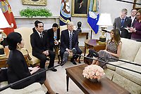 United States President Donald J. Trump and first lady Melania Trump welcome Prime Minister Prayut Chan-o-cha and Madam Chan-o-Cha of Thailand in the Oval Office of the White House in Washington, DC, October 2, 2017. <br /> CAP/MPI/CNP/RS<br /> &copy;RS/CNP/MPI/Capital Pictures