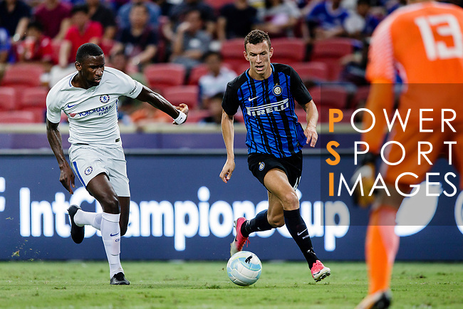 FC Internazionale Forward Ivan Perisic (R) fights for the ball with Chelsea Defender Antonio Rudiger (L) during the International Champions Cup 2017 match between FC Internazionale and Chelsea FC on July 29, 2017 in Singapore. Photo by Marcio Rodrigo Machado / Power Sport Images