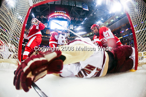 Jason Lawrence (BU 21) sends Andrew Orpik (BC 27) into the back of the net after the puck. The Boston College Eagles defeated the Boston University Terriers 4-3 in overtime in their first Monday Beanpot matchup on February 4, 2008 at the TD Banknorth Garden in Boston, Massachusetts.