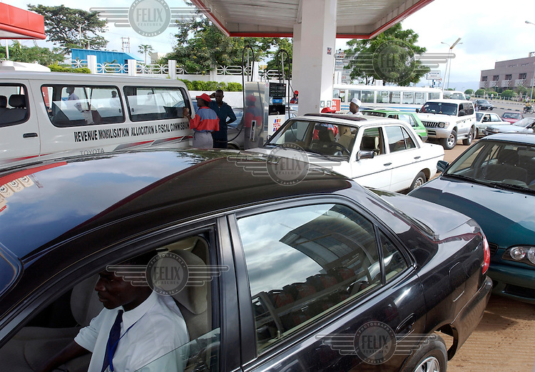 Drivers wait in line to buy fuel at a petrol station owned by the French oil company Total.