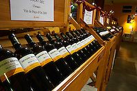 Muscat Sec Classic Vin de Pays d'Oc 2005 on display. Domaine Gerard Bertrand, Chateau l'Hospitalet. La Clape. Languedoc. The wine shop and tasting room. France. Europe. Bottle.