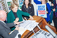 Democratic presidential candidate and Massachusetts senator Elizabeth Warren talks with NH Secretary of State William M. Gardner as she files paperwork to get on the primary ballot at the NH State House in Concord, New Hampshire, on Wed., November 13, 2019. To get on the ballot for the primary, the candidate must sign the required paperwork and pay a $1000 filing fee. Candidates also traditionally all sign a single ceremonial ballot.