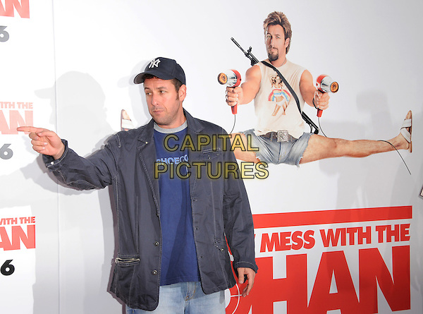 "ADAM SANDLER .The Columbia Pictures' World Premiere of ""You Don't Mess with the Zohan"" held at The Chinese Theatre in Hollywood, California, USA..May 28th, 2008        .half length jacket baseball cap hat hand v peace sign.CAP/DVS.©Debbie VanStory/Capital Pictures."