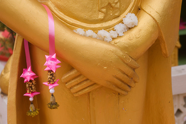 LAOS, VIENTIANE, VAT SISAKET, BUDDHA STATUE WITH OFFERINGS, DETAIL