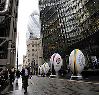 London, England City workers look on at Rugby balls set out for the media at a press conference to announce the England rugby squad for the QBE Internationals on October 25, 2012 in London, England