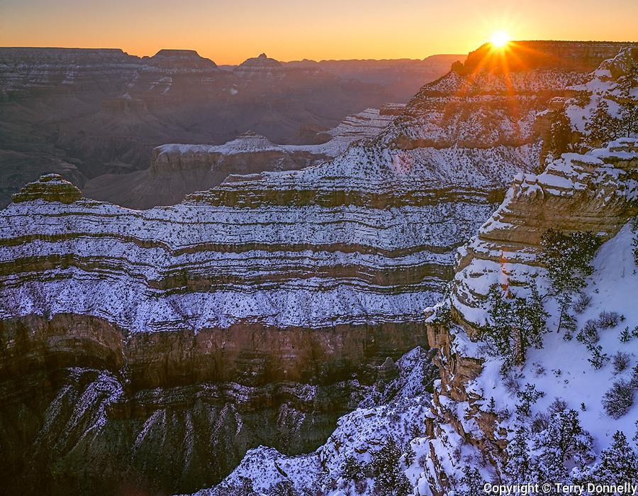 Grand Canyon National Park, AZ   <br /> Winter sunrise breaks over Cedar Ridge, from Mather Point