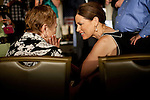 GOP Presidential candidate Rep. Michele Bachmann talks to a supporter at a rally in Davenport, Iowa, July 24, 2011.