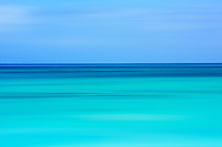 Horizontal motion during the exposure is used to make this abstract photograph of the aquamarine waters of the West Indies.