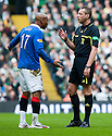 :: RANGERS' EL HADJI DIOUF IS SPOKEN TO BY REF IAIN BRINES ::