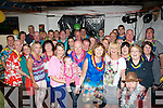 6-OH CELEBRATIONS: Eugene Deady (front centre) Boston, USA and origanilly from Talaught, Fenit, got a big shock as his wife Marian, family and friends organised a surprise Hawaiian style 60th birthday party at his home in Talaught, Fenit last Saturday night.