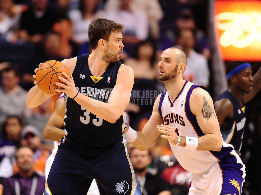 Jan. 28, 2012; Phoenix, AZ, USA; Memphis Grizzlies center Marc Gasol (left) against Phoenix Suns center Marcin Gortat at the US Airways Center. The Suns defeated the Grizzlies 86-84. Mandatory Credit: Mark J. Rebilas-USA TODAY Sports